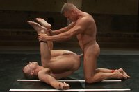 Huge dicked Tyler Saint takes on a young muscle stud. Skill and experience versus youth and endurance. Someone's getting their ass pounded either way.