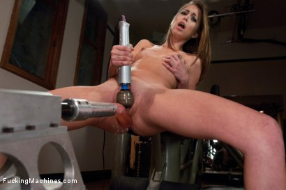 She's 20, smoking hot in gym socks & getting a pussy workout. Riley squirts on the machine cock, & the Sybian fucks her in to cum space in piledriver.