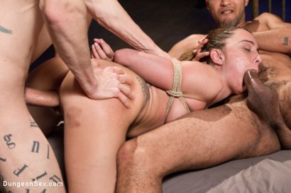 Dungeon slut suspended and make love by two huge cocks. Roxanne