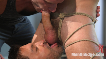 Lean hunk with a big cock blows his load mid-air!