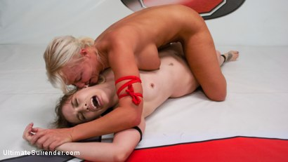 Blonde pain slut and all natural brunette battle in a sex fight.